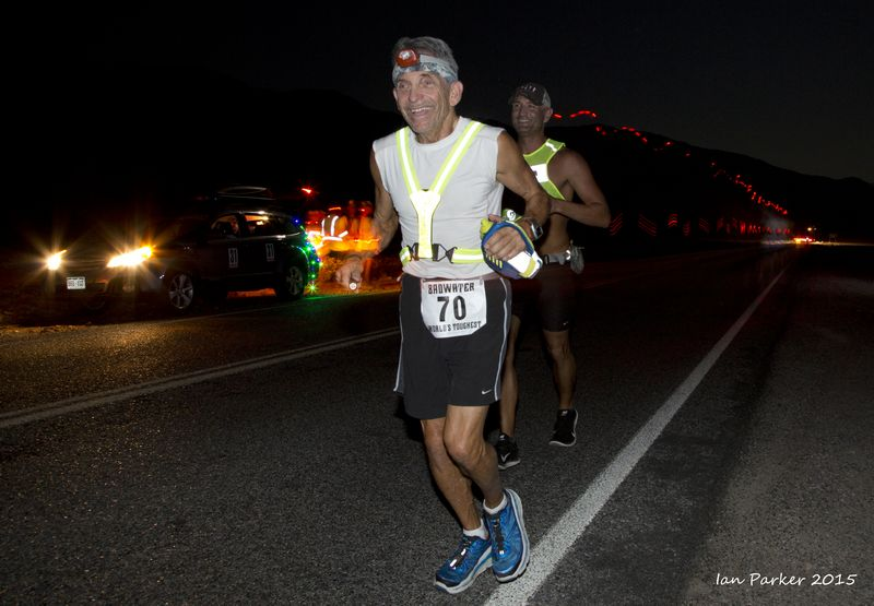 Night-time running past crew vehicle, Bob Becker: 2015 Badwater Ultramarathon